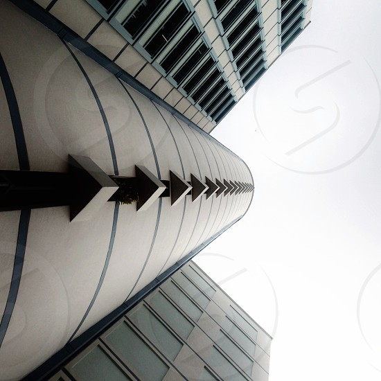 white and gray high rise building in low angle photography photo