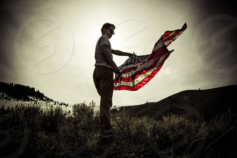 man holding american flag photo