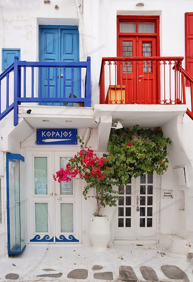 Mykonos greece old town architecture flower white blue red  photo