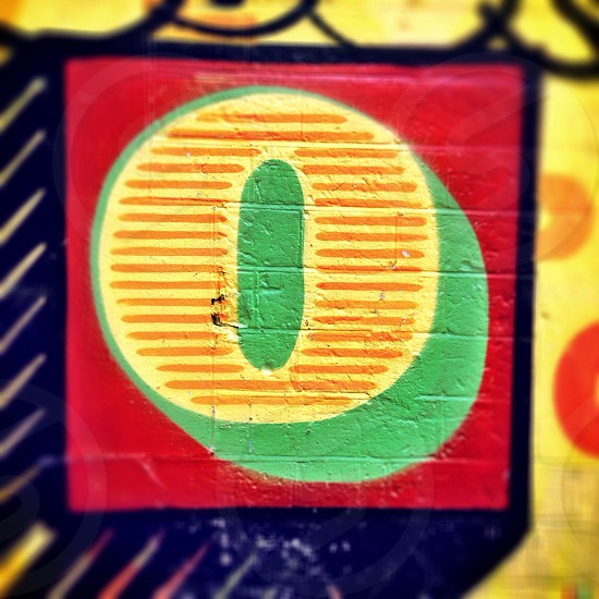 Letter O. Detail of street art by artist Ben Eine in Shoreditch London England.  photo