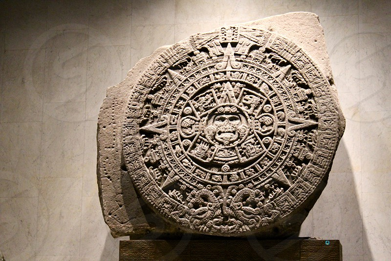 Mexico City - Visit the Museum of Anthropology and History and sit to admire the Sun Stone an ancient sculpture hundreds of years old. photo