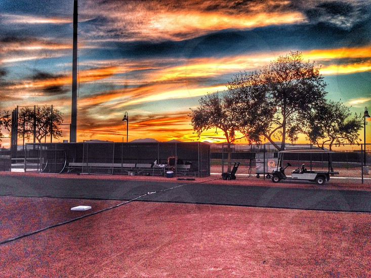 Sunset after a baseball game. photo