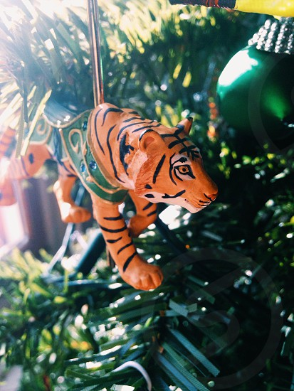 tiger toy on christmas tree photo