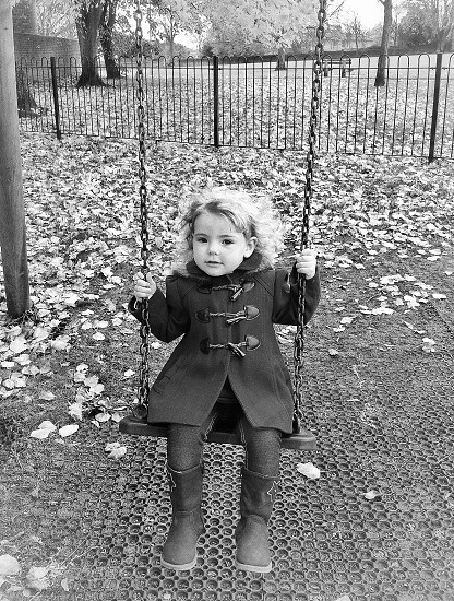 Swing. Child portrait. Black and white. Fun. Outdoors. Park.  photo