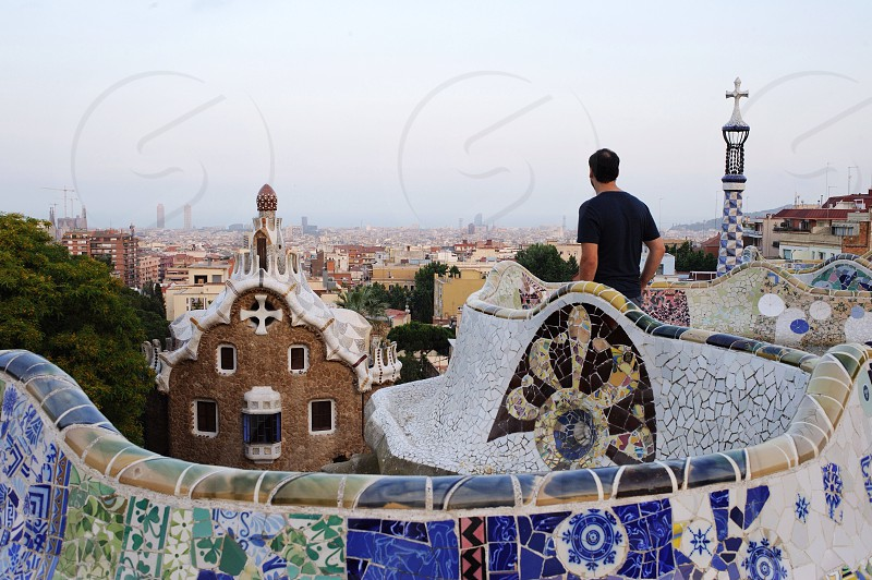 A traveler enjoys the view from Barcelona's Park Güell. photo