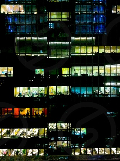 side of an office building view at night photo