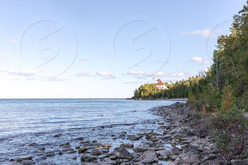 The view of the Cabot Head lighthouse along the Georgian Bay just south of Tobermory on the Bruce Peninsula of Canada. photo