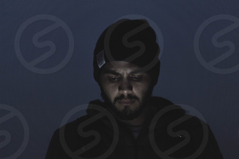 angle view of a man on black bonnet and black hoodie jacket during night time photo