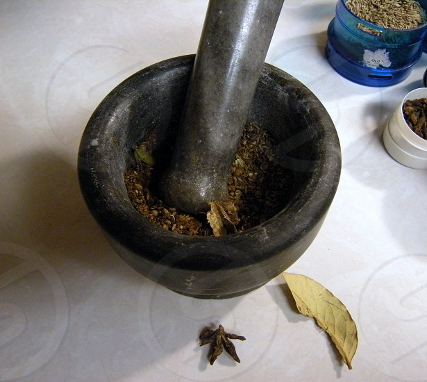 Indian spices with mortar and pestle photo