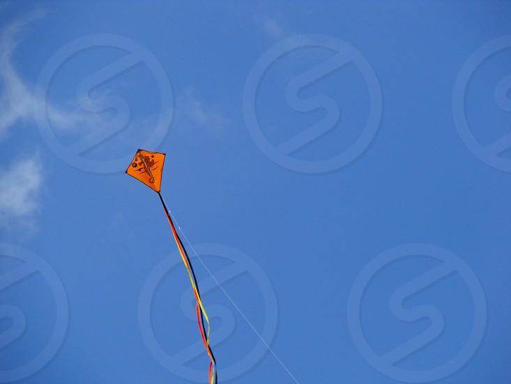 orange kite flying photo