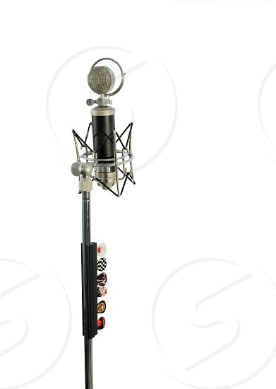 Vocal condenser microphone with wind screen isolated on white background. photo