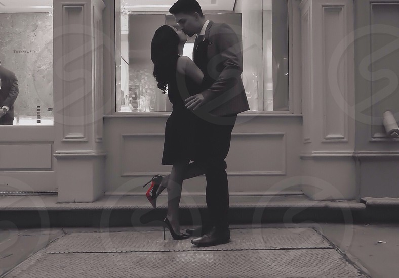 couple kissing grayscale photography photo