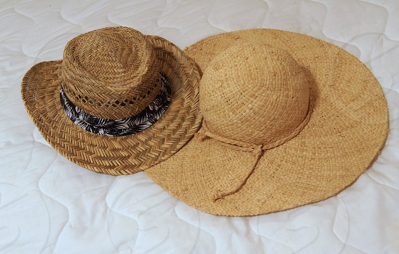 brown wide brimmed hat with cord photo