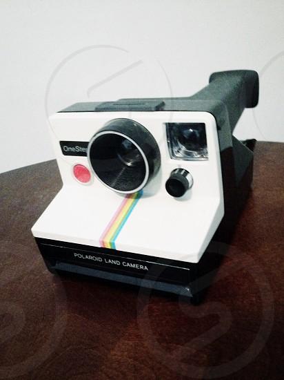 white and black polaroid land camera photo