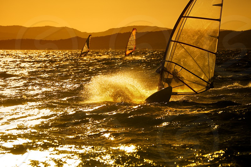 windsurf;  wave;  sea;  ocean;  summer;  wind;  sail;  people;  athlete;  competition;  effort;  sport;  active;  man;  speed;  exercise;  challenge;  healthy lifestyle;  strength;  vitality;  sunset;  guy;  waves;  summertime;  competitive;  summery;  competitiveness;  action;  seascape;  contest;  activity;  agile;  agility;  summer time;  compete;  competing;  striving;  strong;  challenging;  liveliness;  lively;  speed;  speeding;  vigorous;  sundown;  wet suit;  windsurfing;  foam;  spry photo