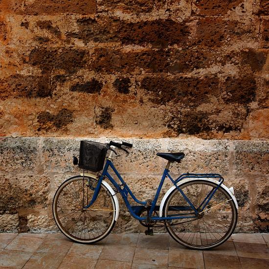 Bicycle in historical Ciutadella stone wall at Balearic islands photo