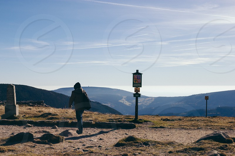 Lonely man standing at the break of the mountains photo