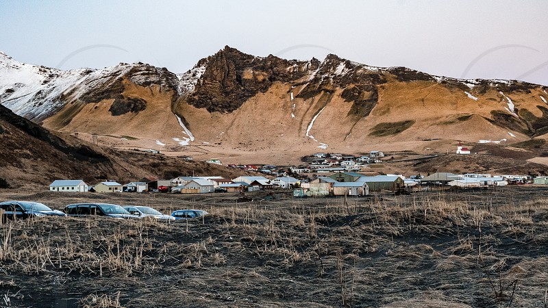 The town of Vik in Iceland taken from the black pebble beach photo