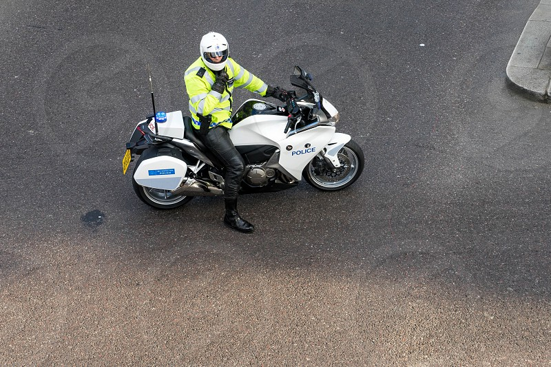Metropoliatan Police traffic officer clearing the way for a VIP photo