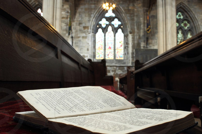 A hymn book resting on an empty pew in Doncaster Minster.  photo