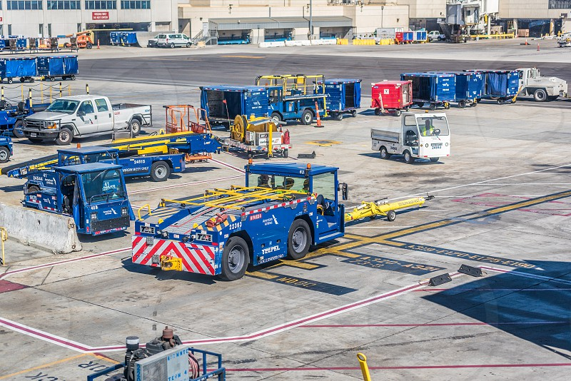 Vehicles on the tarmac at an airport. photo