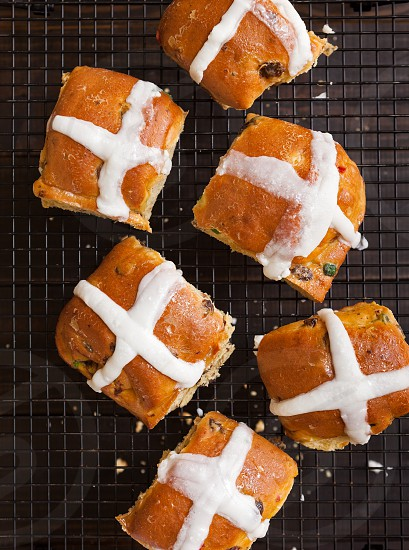 Overhead view of hot cross buns on a cooling rack photo