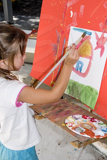 Little girl creative painting  photo