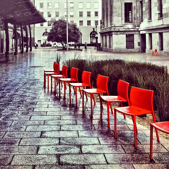 Empty chairs in an urban plaza photo