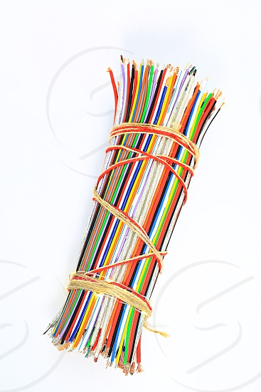 "Topic:""Bundle of Wires"" 8  This is an image of a bundle of electronic wires in multiple colors tied up with string with copy space and a clean white background. photo"