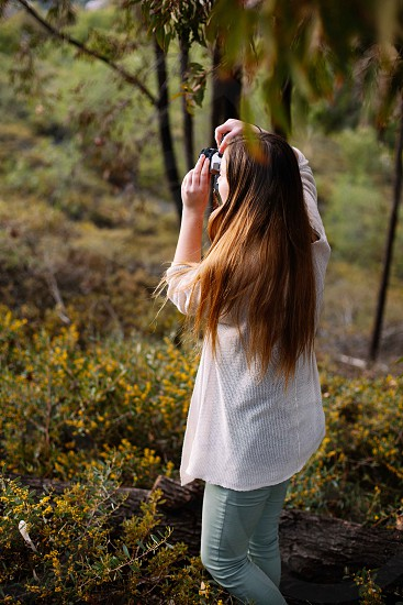 woman taking a picture outdoor photo