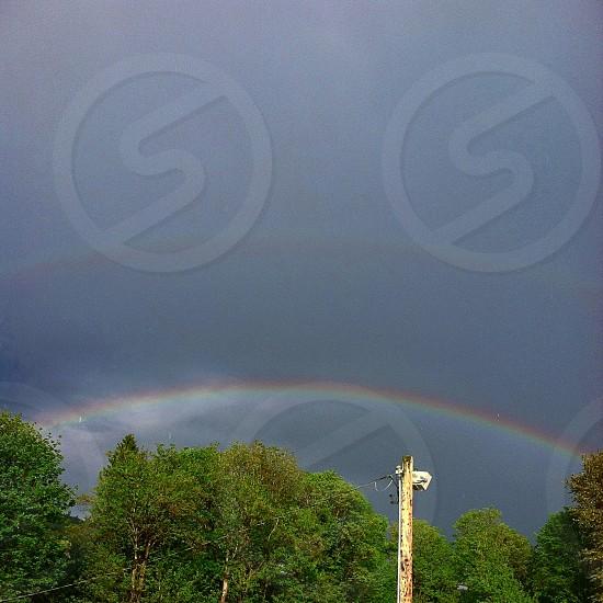 double rainbow against a dark sky. photo