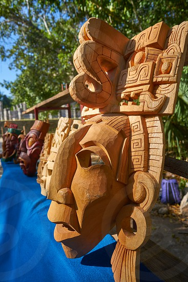 Chichen itza Mayan handcrafted wooden masks in Yucatan Mexico photo