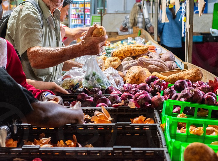 Man shopping at Farmer's Market in South Melbourne photo