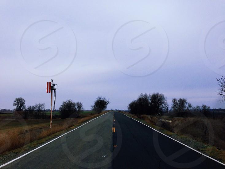 concrete road with tree photo