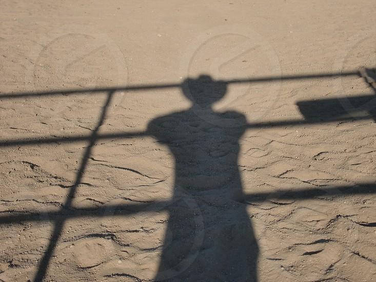 shadow of man wearing cowboy hat during daytime photo