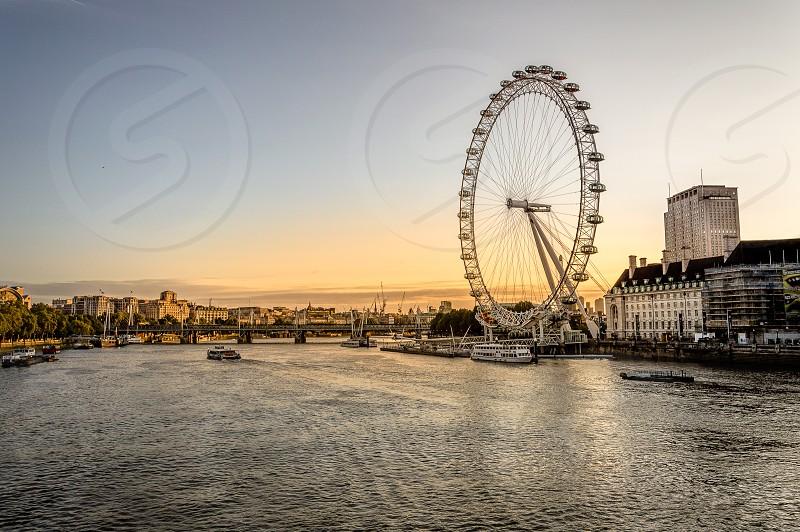 London skyline at sunrise. With Sea Aquarium and The London Eye on River Thames photo