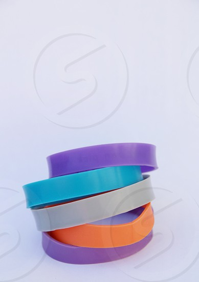 purple blue orange and white rubber bracelets photo