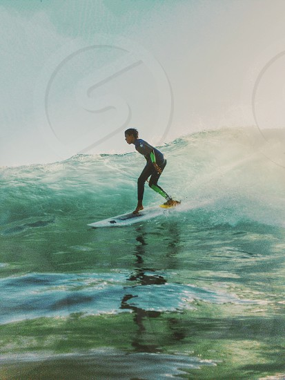 man riding surf board on waves photo