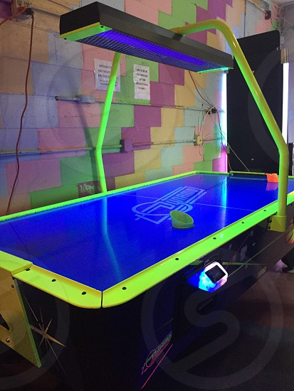 Neon table hockey in an arcade. photo