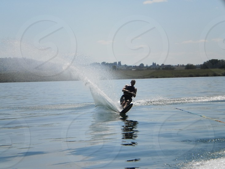 Man waterskiing on lake photo
