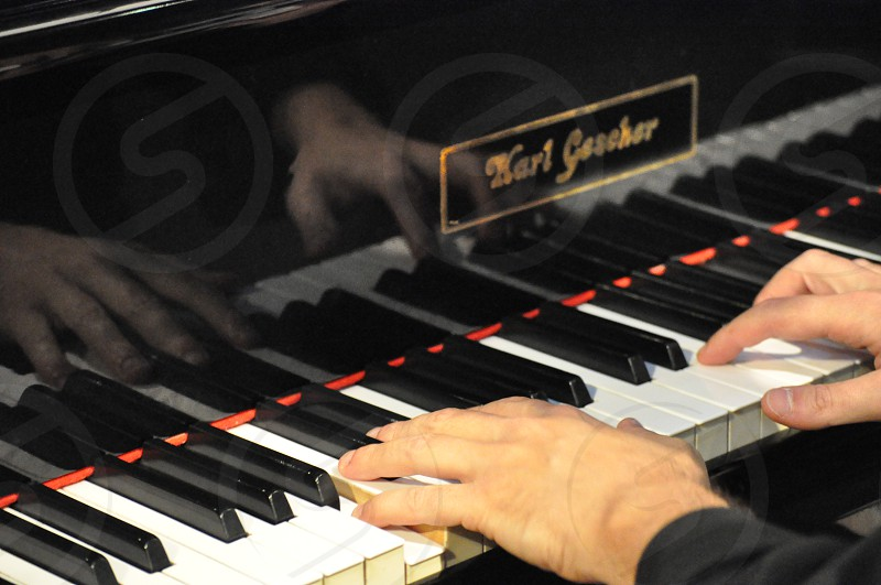Pianist hands playing piano isolated classical music pianist photo