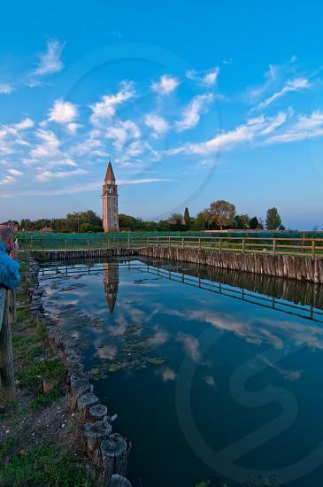 "Venice Burano Mazorbo vineyard with ""campanile"" belltower of Saint Caterina on background photo"