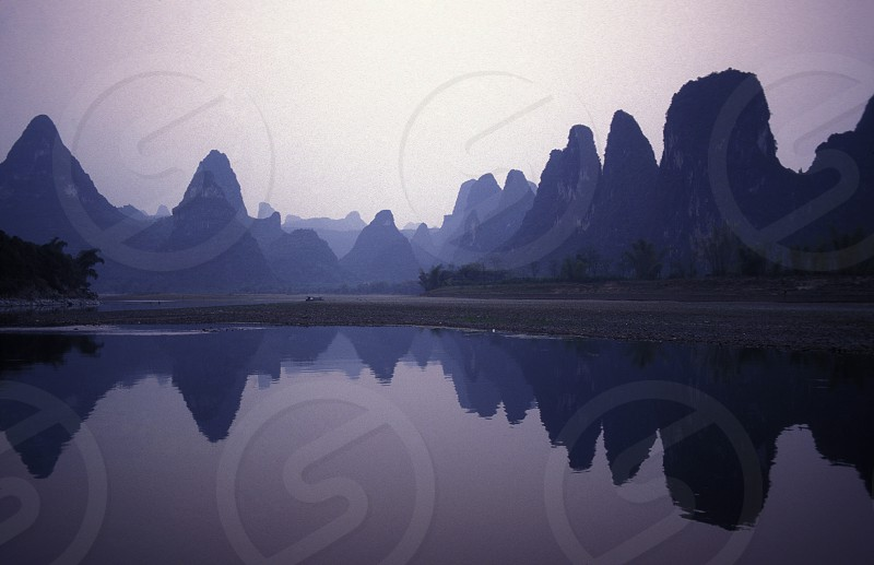 the landscape at the Li River near Yangshou near the city of  Guilin in the Province of Guangxi in china in east asia.  photo