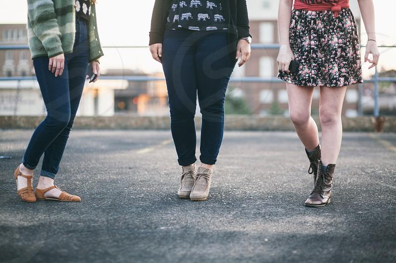 3 women standing on gray floor photo