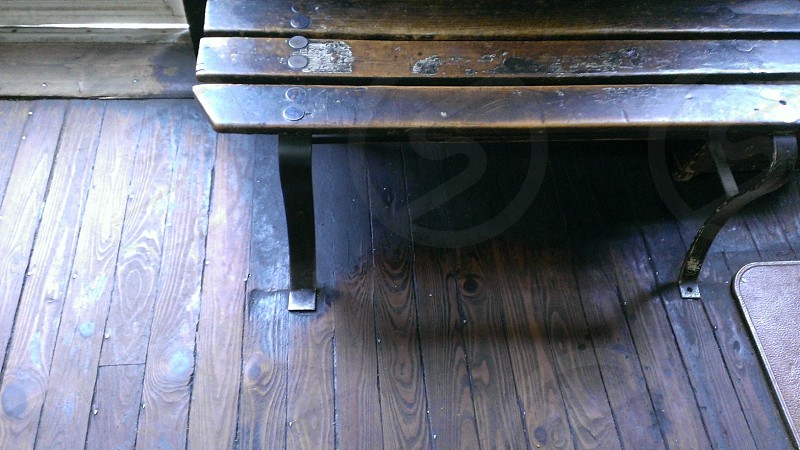 gray metal framed wooden bench photo
