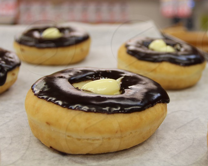 Chocolate iced cream filled dougnuts photo