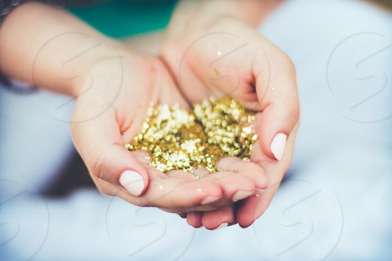 glitter fashion gold hands close up color sparkle photo