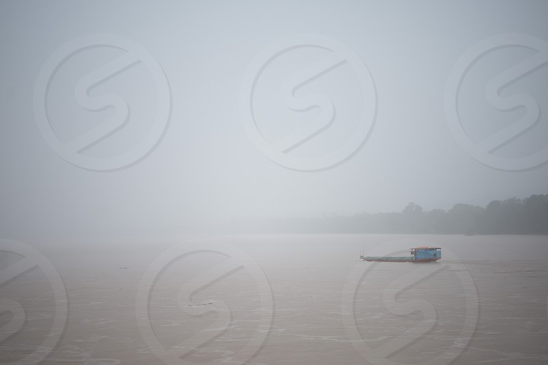 a ship at the mekong river in Nong Khai in Isan in Thailand in the southeastasia. photo