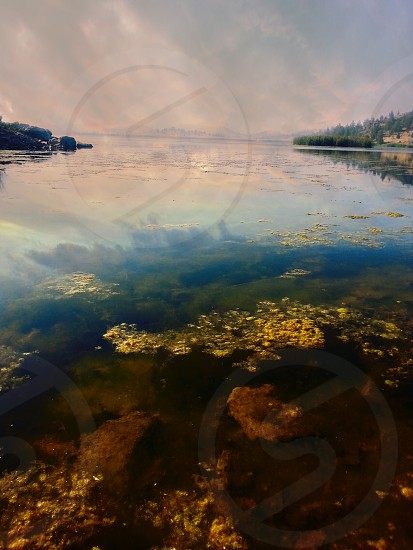 This lakes calm and tranquil surface and the mysterious beauty and wonder are almost touchable. photo