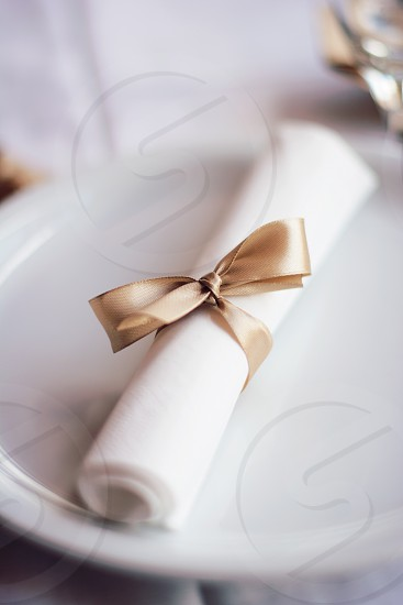 Wedding decorations napkin tied with a bow photo